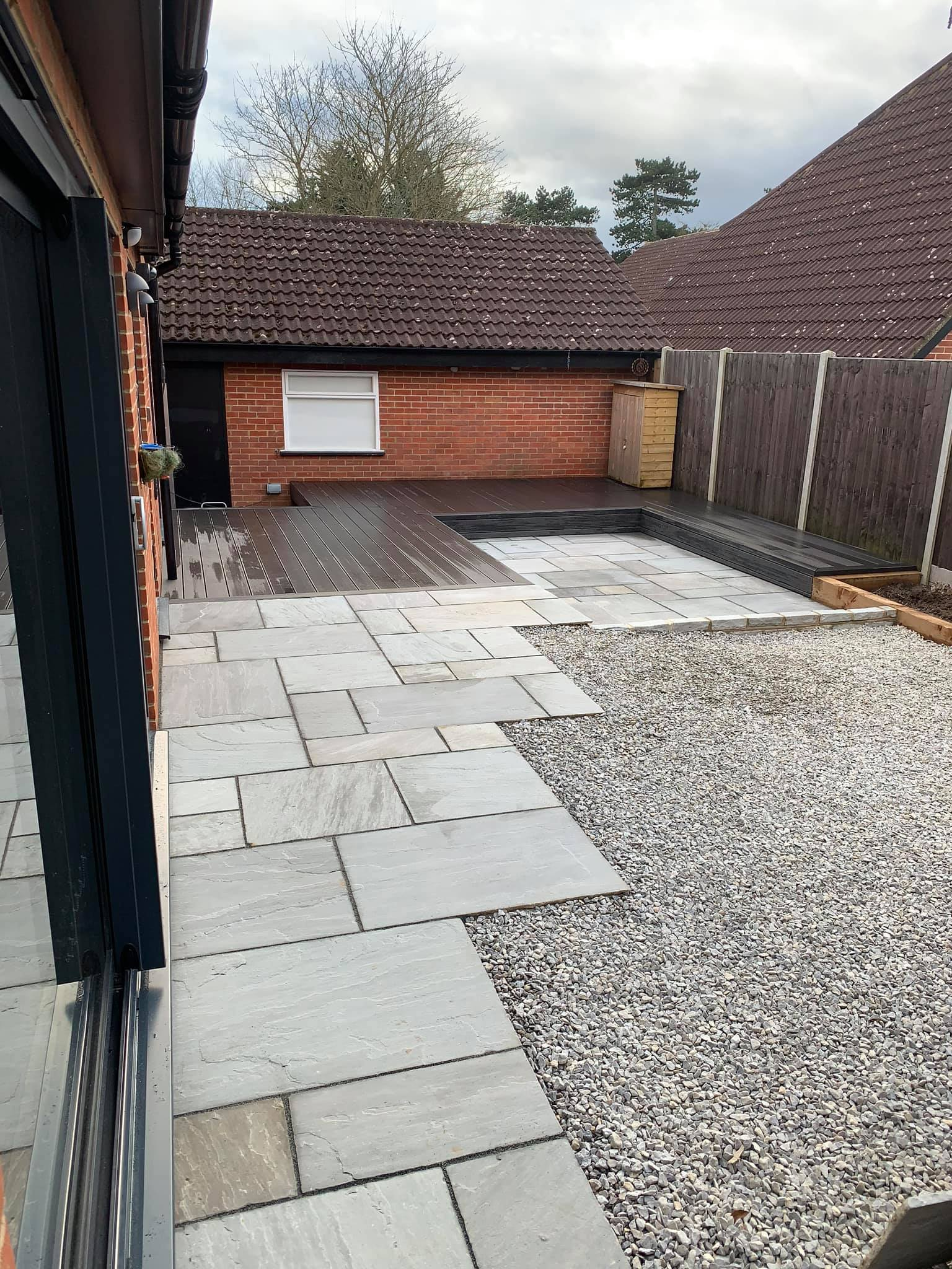 paved area with decking and gravel